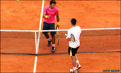 Rafa Nadal and Robin Soderling shake hands after the Swede's win last year