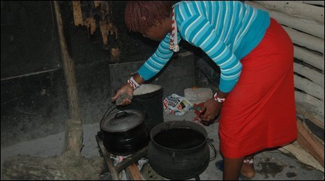 A young traditional healer prepares a meal at Magwaza Msimango's home in Matafeni