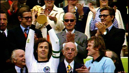 German legend Franz Beckenbauer lifts the World Cup