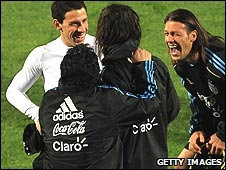 Martin Demichelis (right) laughs with his Argentina team-mates and head coach Diego Maradona