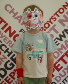 Boy wearing a bug mask