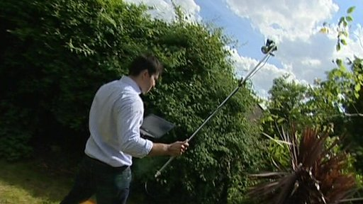 Reporter Sharif Sakr tries to get a signal using a home-made antenna