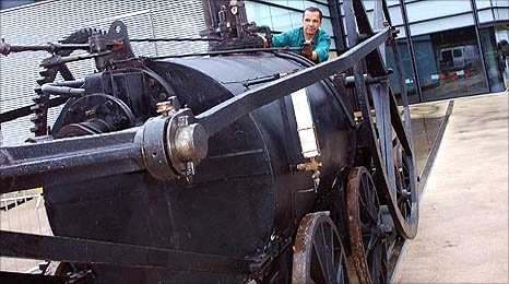 image shows the locomotive being driven outside the museum in Swansea
