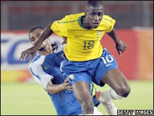 Brazil's Ramirez jumps to escape a tackle from Tanzania's Homoud