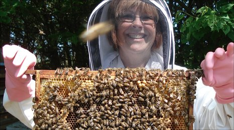 BBC Radio Suffolk presenter lesley Dolphin with a rack of bees