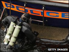 Police diver patrols the Thames ahead of the G20 summit in London