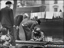 Divers in the Grand Union Canal in London  searching for a body in 1953