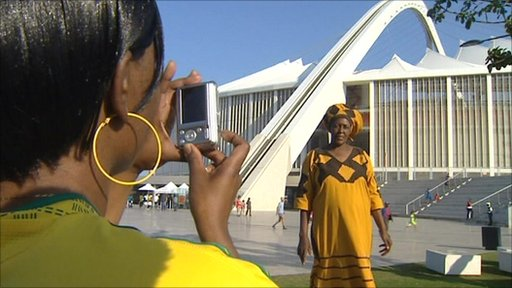 People having photograph taken outside Durban stadium