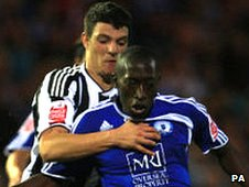 Haris Vuckic (left) tussles with a Peterborough player