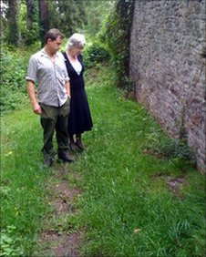 Carole White with Nick Bull at the site of the grave