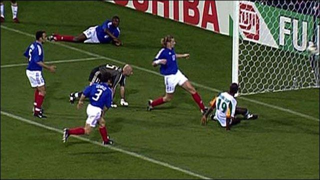 Papa Bouba Diop scores against World Champions France