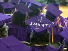 """US high school graduation with """"I is smart"""" written on one mortarboard"""