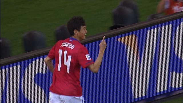 Lee Jung Soo celebrates after scoring for South Korea