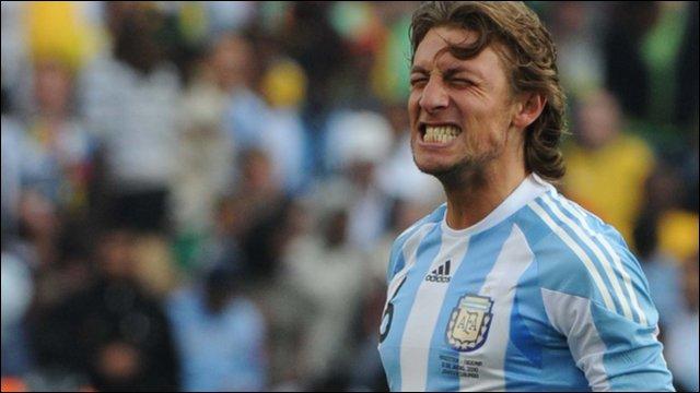 Argentine defender Gabriel Heinze celebrates scoring