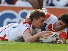 Sam Tomkins touches down for one of his tries