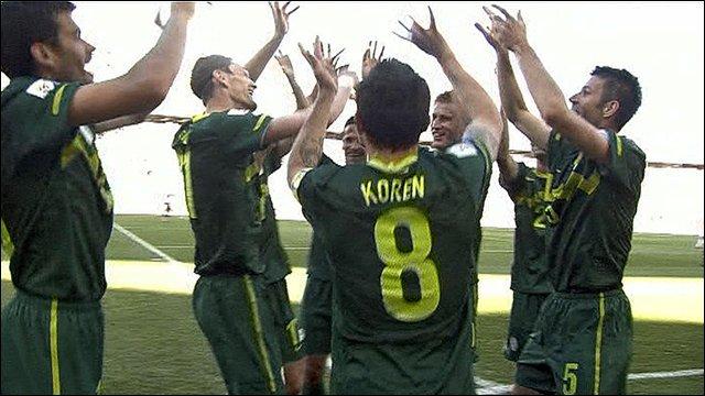 The Slovenia team celebrate