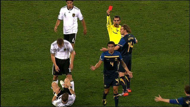 Tim Cahill is shown a red card