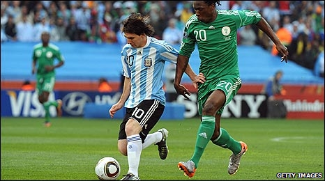 Argentina's Lionel Messi holds off Nigeria's Dickson Etuhu