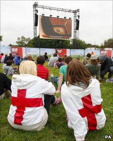 Football fans watch the World Cup big screen at the Isle of Wight Festival