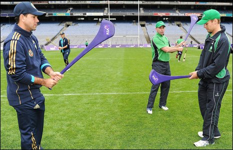 Ricky Ponting and William Porterfield (right) try out hurling at Croke Park