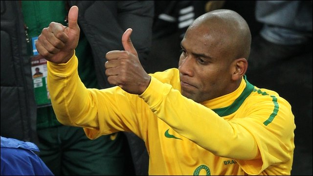 Brazili's Maicon celebrates after beating North Korea