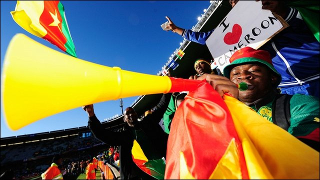 A Cameroon fan blows a vuvuzela