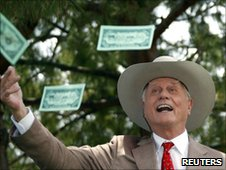 "Actor Larry Hagman who played ""J.R. Ewing"" on television series ""Dallas"" throws fake dollars notes"