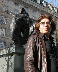 Nasser Azam with his statue 'The Dance'