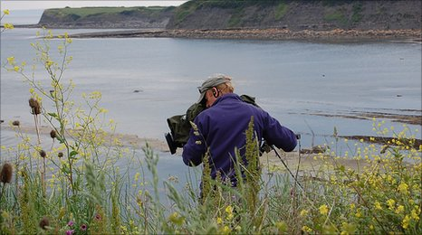 A Springwatch 2010 cameraman at work in Kimmeridge Bay