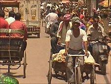 Cycle-rickshaws on a busy Delhi street