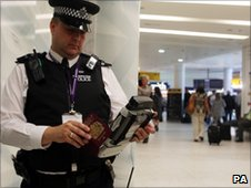 Police officer checks passport