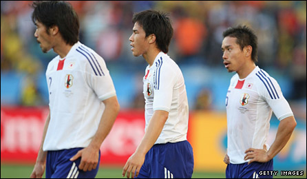 Japan's players at the final whistle
