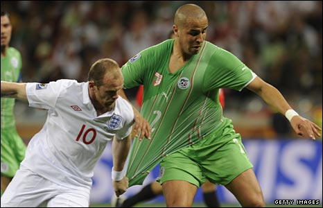 Wayne Rooney resorts to pulling Madjid Bougherra's shirt
