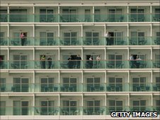 Passengers look out from balconies on the 'Liberty of the Seas'