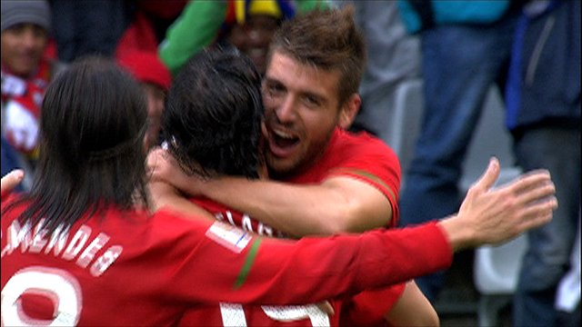 Portugal's Tiago celebrates his second goal with his teammates