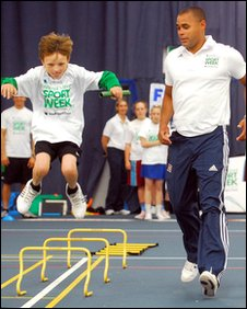 Jason Gardener gives Clayton from nearby Alsop High School, an athletics master class.