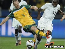 Solley Muntari (R) and Australia's Craig Moore
