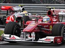 Ferrari's Fernando Alonso leads McLaren's Lewis Hamilton