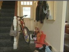 A miniature bike in the hallway of a dolls house