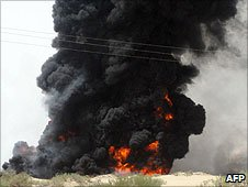 Black smoke rises from an oil pipeline near Marib after it was blown up by Yemeni tribesmen