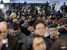 Brazilian reporters await a news conference by Kaka