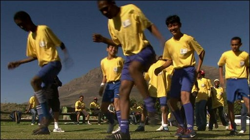 South African children demonstrate their football warm-up