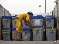 An electoral worker checks ballot boxes in Baghdad, May 2010
