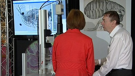 Susan Watts, Dr Brad Amos and the giant lens microscope