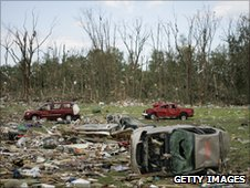 Debris and damaged cars are scattered after a tornado hit the area on June 6, 2010 in Millbury, Ohio