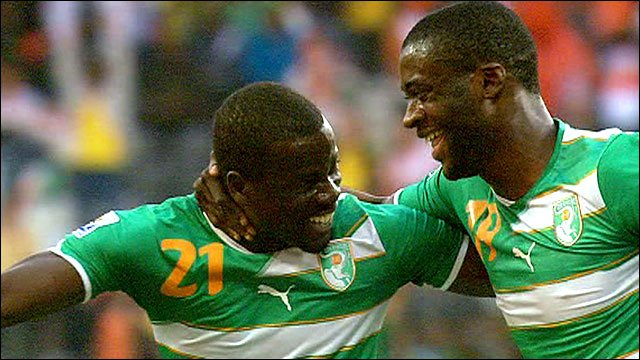 Ivory Coast's Yaya Toure celebrates with Emmanuel Eboue