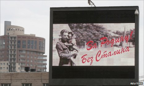 "Billboard which reworked WWII slogan ""For Motherland! With Stalin"""