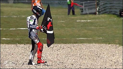 Jorge Lorenzo celebrates MotoGP win with some robotics