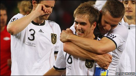 Philip Lahm is hugged by Lukas Podolski