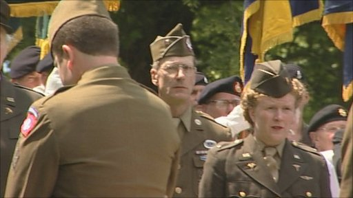 American servicemen and women attend the memorial